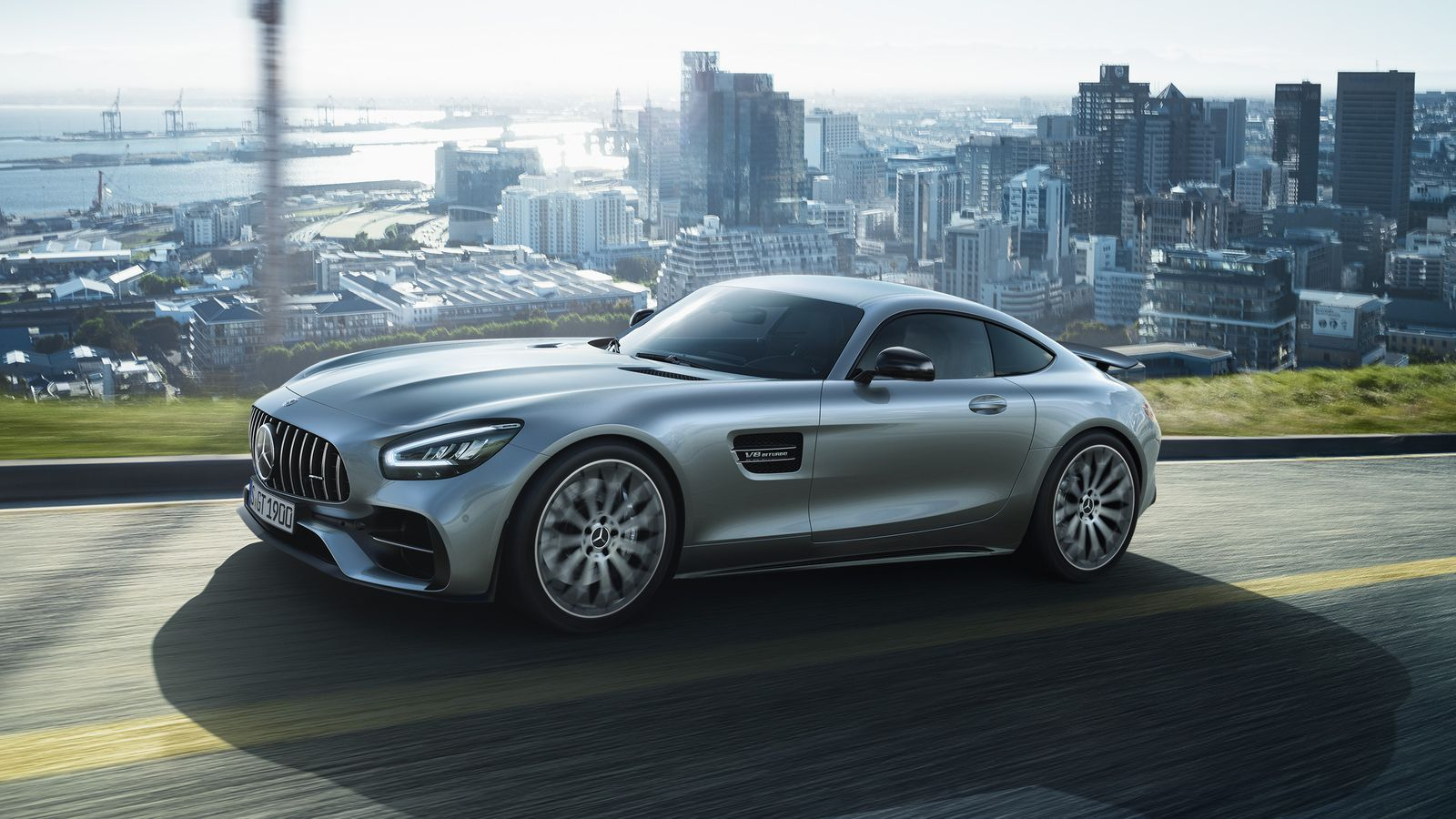 2019 Mercedes AMG GT car in the foreground and a city landscape in the background
